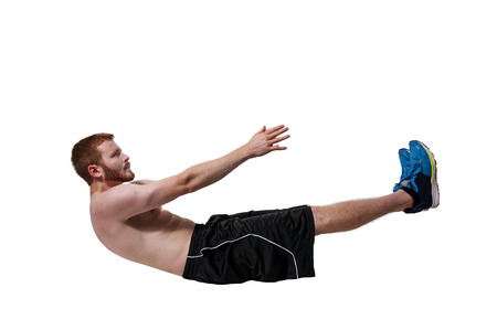 crunches: Young man doing exercises by doing crunches