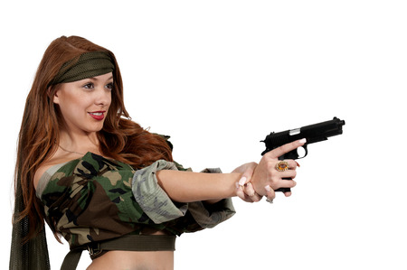 Gun toting beautiful young woman soldier with a pistol Stock Photo