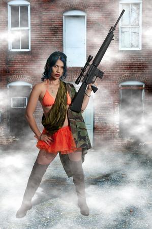 sexy black woman: Beautiful young woman holding an automatic assault rifle