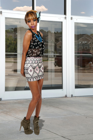 stilleto: Beautiful young sexy black African American woman in a dress and heels posing