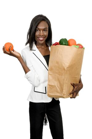 carrying: Beautiful woman grocery shopping holding a brown paper bag
