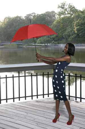 Beautiful woman holding a colorful and fashionable umbrella