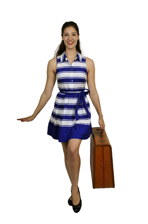 hot chick: Beautiful young woman going on vacation with a vintage suitcase