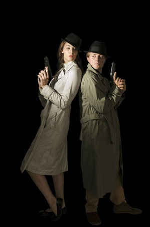 secret agent: Man and woman secret agent spies with guns
