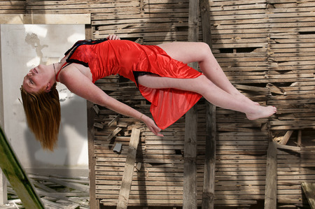 wican: Beautiful young woman floating in the air