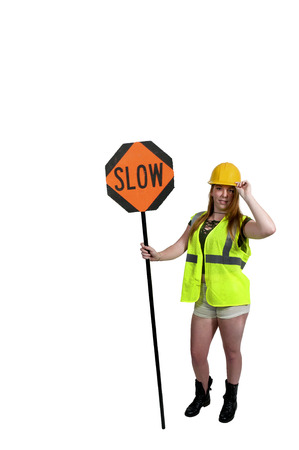 Woman flagman holding a stop sign to halt traffic Stock Photo
