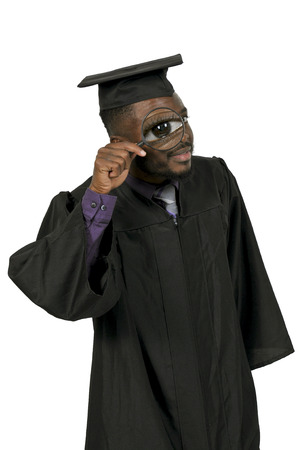 Young man in his graduation robes Stock Photo