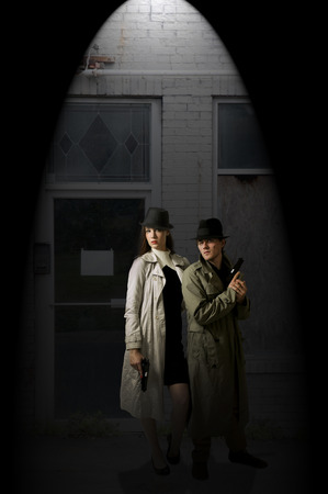Man and woman secret agent spies with guns