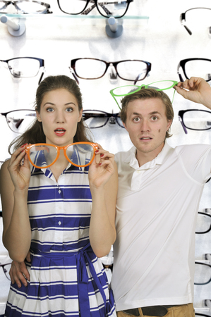 Young couple with silly goofy oversized glasses photo