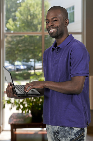 african business: Black African American man business student computer user Stock Photo