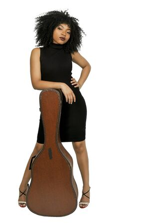 Beautiful young woman with a acoustic guitar case Stock Photo