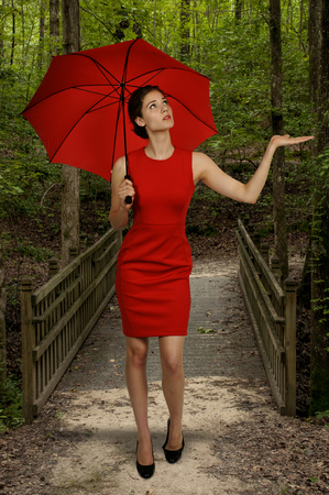 Beautiful woman holding a colorful and fashionable umbrella photo
