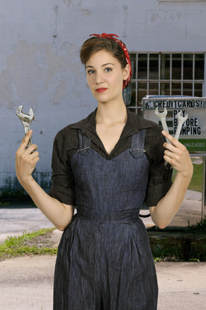 Beautiful woman dressed as the iconic Rosie the Riveter photo