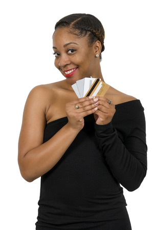 shopping spree: Beautiful young African American black woman on a shopping spree with credit and debit cards Stock Photo