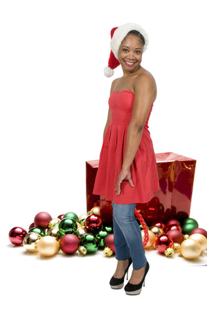 Beautiful young woman wearing a Santa hat