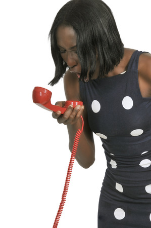 Beautiful woman yelling in to a phone