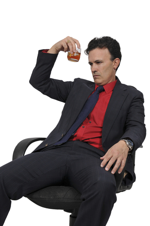 alcoholic drink: Handsome business man holding an alcoholic drink