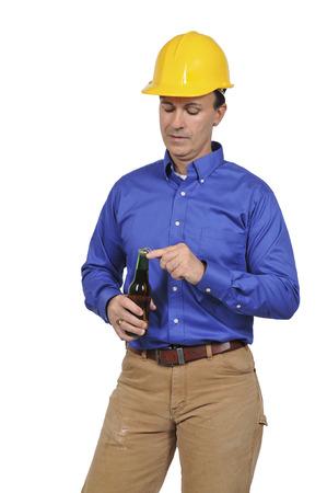 Handsome construction worker having an after work beer