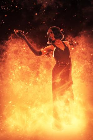 火の中に立って美しい女性 写真素材