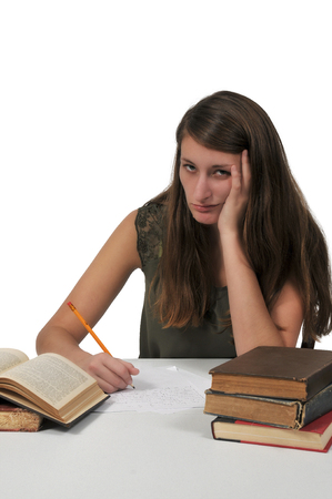 Beautiful young woman doing her school homework