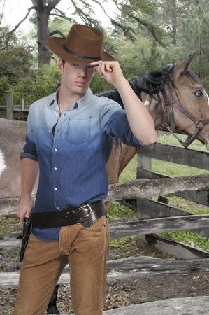 buckaroo: Handsome cowboy man with six shooter guns