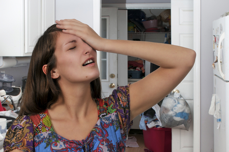 Beautiful forgetful woman with her hand on her forehead Stock Photo