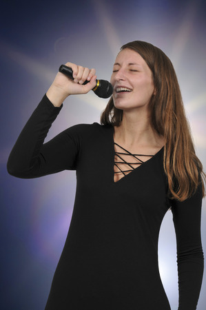 Beautiful woman singer performing at a concert Stock Photo