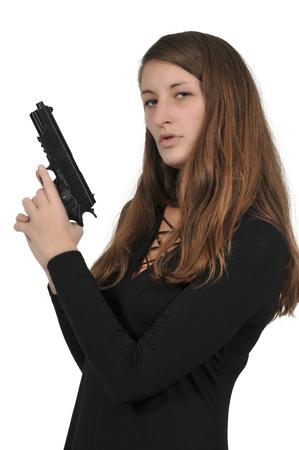 Beautiful young woman holding a loaded handgun Stock Photo