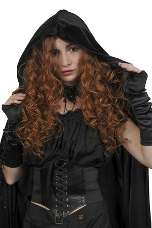 Beautiful woman wearing a long black cloak