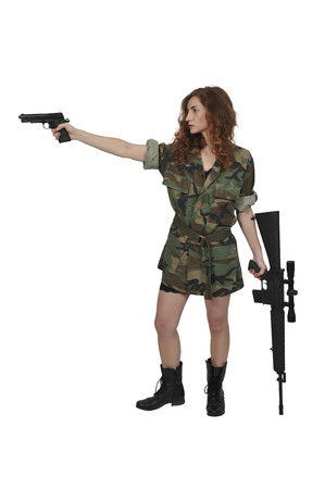 Beautiful young woman soldier with a pistol and rifle Stock Photo