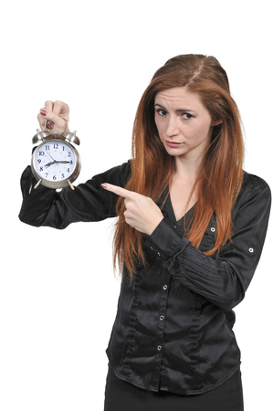 Woman counting the time on an alarm clock