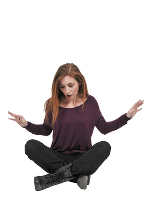 Young Beautiful Woman sitting on the floor Stock Photo