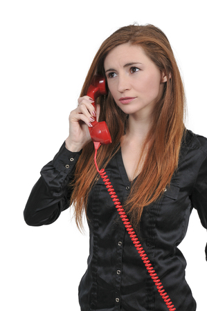 Beautiful young woman talking on a phone Stock Photo