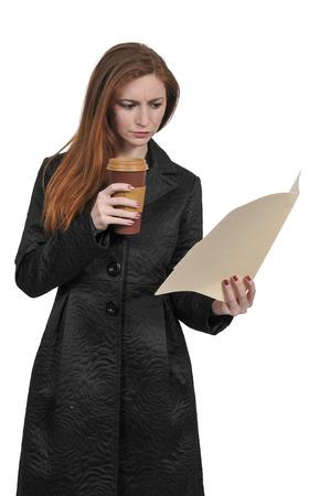 Beautiful young woman lawyer or business woman holding a manila file folder