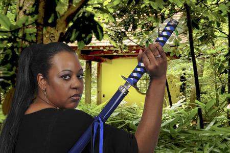 bushido: Woman with a samurai bushido katana sword Stock Photo