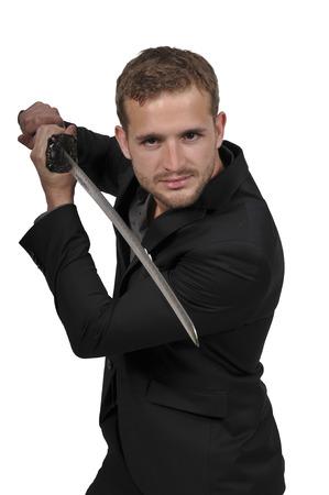 Young man with a samurai bushido katana sword