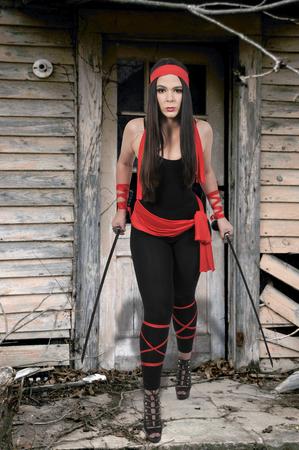bushido: Young woman with a samurai bushido katana sword