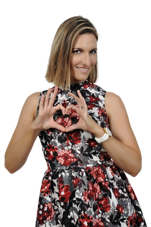 heartfelt: Beautiful woman making a heart shape with her hands