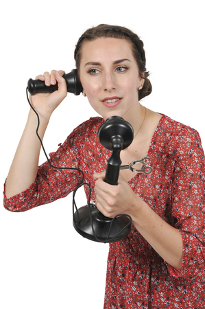 Woman using an old timey vintage candlestick phone Stock Photo