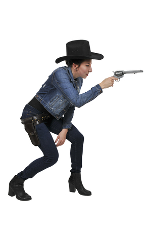 Beautiful young country girl woman wearing a stylish cowboy hat and revolver