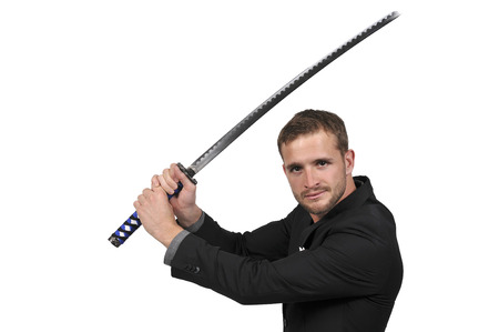 Young man with a samurai bushido katana sword