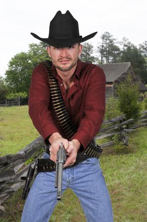 Handsome cowboy man with six shooter guns