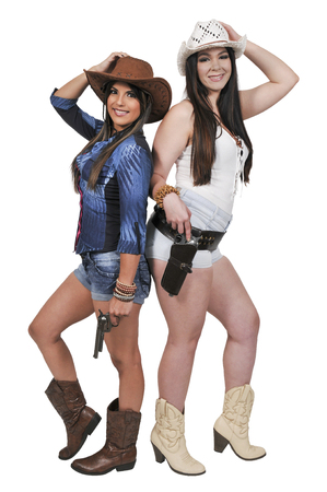 Beautiful young country girls women wearing a stylish cowboy hats and revolvers