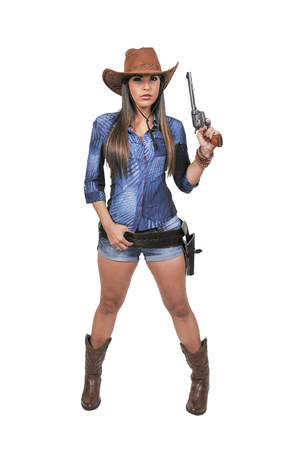 shooters: Beautiful young country girl woman wearing a stylish cowboy hat and revolver