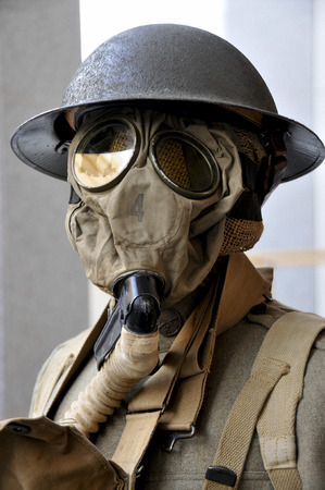 WWI soldier wearing a protective gas mask