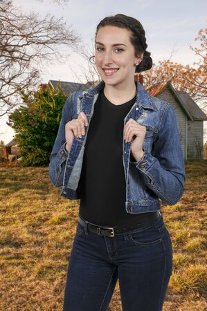 Beautiful woman wearing a pair of blue jeans and a denim jacket Stock Photo