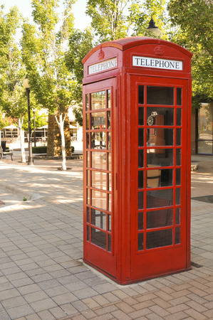 antique booth: Vintage phone booth used before the age of cell phones