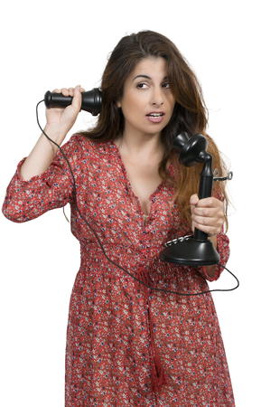 conservative: Woman using an old timey vintage candlestick phone Stock Photo
