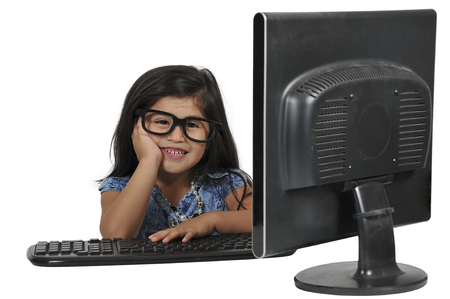 Beautiful computer savvy little girl using a computer Stock Photo