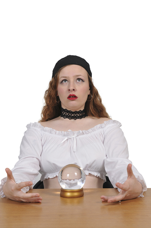 Woman gypsy fortune teller using a crystal ball
